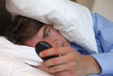 phone in bed avoiding insomnia and daytime sleepiness