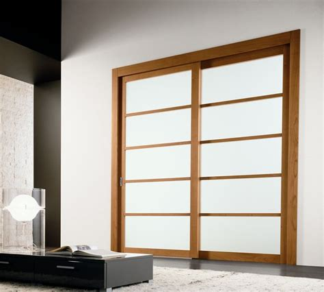 Sliding Wood Doors Interior Modern Interior Sliding Door Featuring A Bianco Latte Panel With Cherry Wood Sliding Panel
