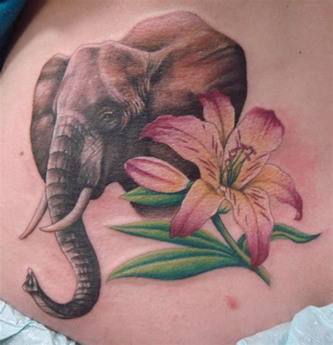 elephant tattoo with flowers elephant n flower design tattoos book 65
