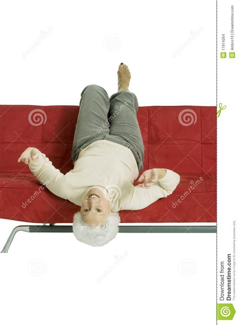 relaxing on the couch elderly woman relaxing on the couch stock images image