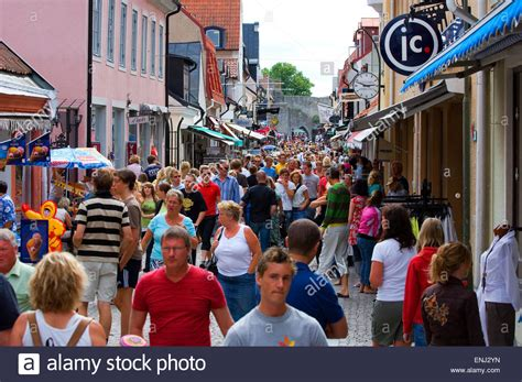 buying a house on a busy street busy street in the small city of visby in sweden stock photo royalty free image