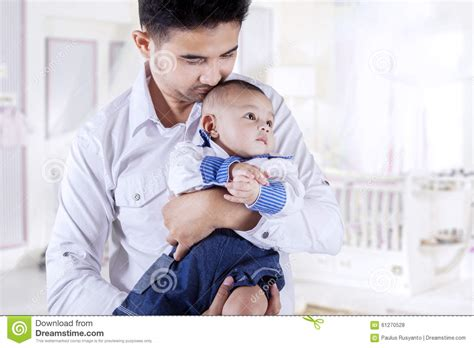 asian mother and son bedroom portrait stock photo getty asian father holding his son in bedroom stock photo