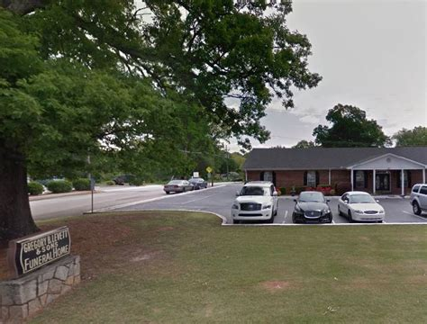 gregory b levett sons funeral home scottdale ga