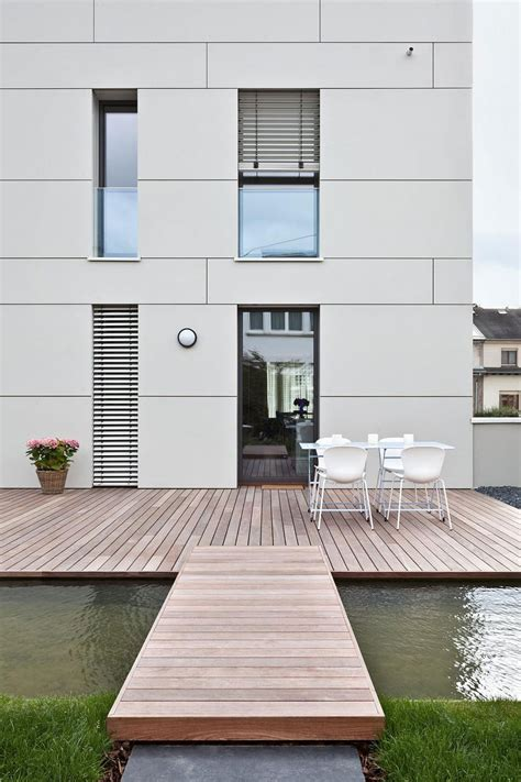 Home Exterior Design Tiles Housing Building Of Seven Units In Kirchberg Keribrownhomes