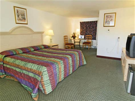 grand king bed americas best value inn and suites of cape cod