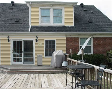 yellow siding with brick siding color options for
