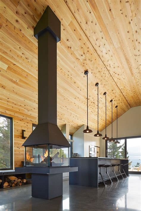 cathedral ceiling lighting expansive quebec residence charms with inviting warmth of wood