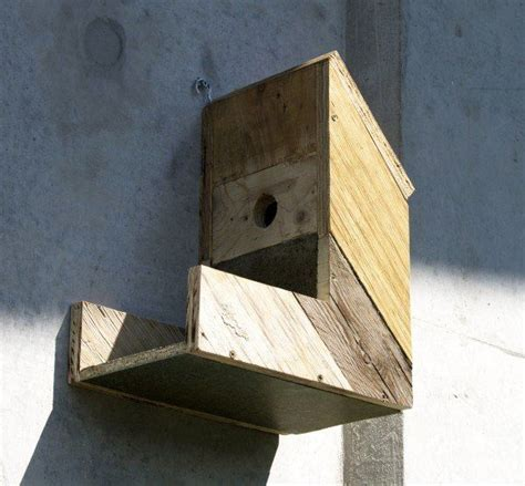 birdhouses made from old construction materials recycled