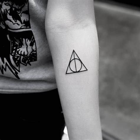 deathly hallows symbol tattoo deathly hallows symbol on the left inner forearm