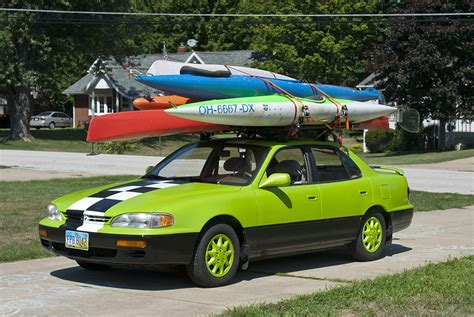 Kayak Rack For Sedan by Five Boats On A Sedan Kayaking