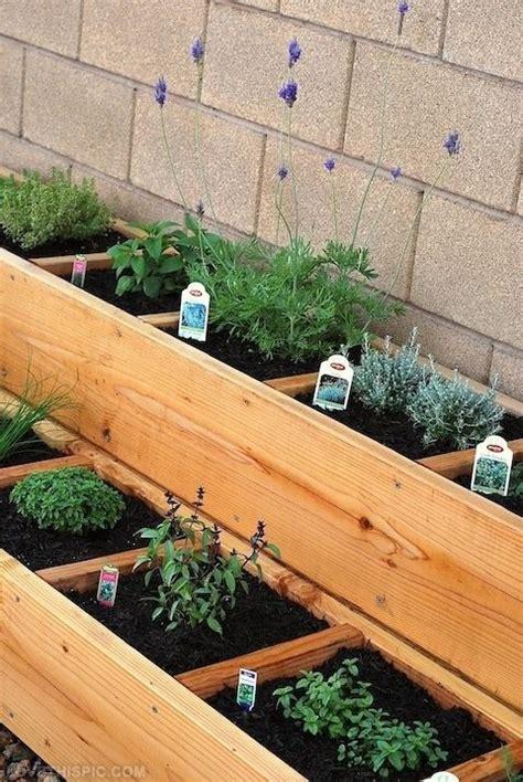 tiered raised garden bed herbs in tiered raised bed garden gardening