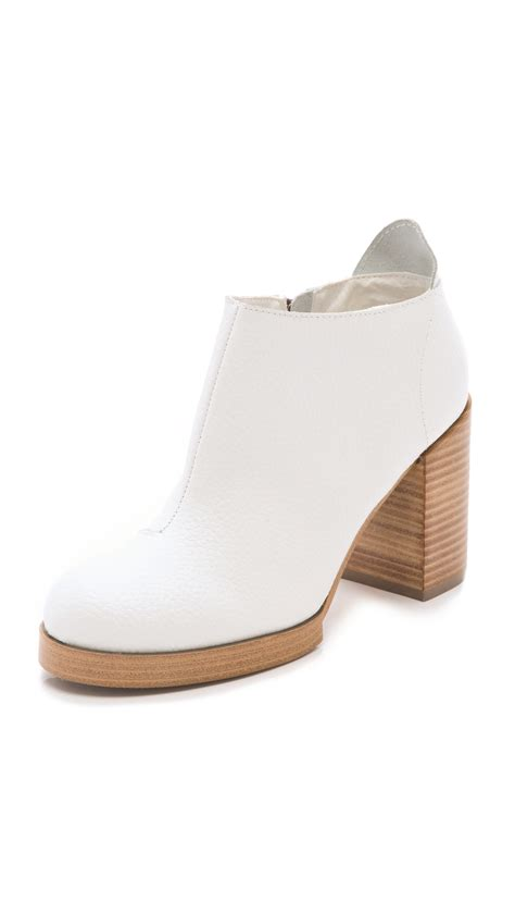chunky cheap cheap monday layer chunky heel booties in white bone lyst
