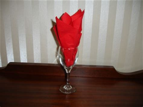 Folding Paper Napkins In Glasses - paper napkins photo courtesy of www napkinfolding us
