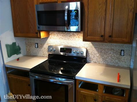 split face travertine tile backsplash the diy village