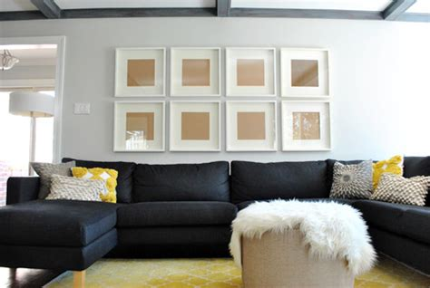 young house love sectional how to hang a grid of frames over the couch and what not