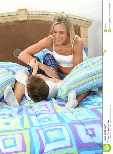 mom son bed mother son tickle fight stock images image 499294