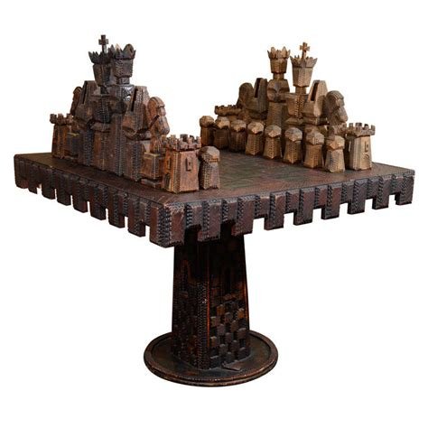 vintage monumental carved game table and chess pieces