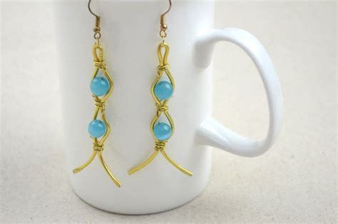 Handcrafted Copper Earrings - diy golden handcrafted copper earrings combined with blue