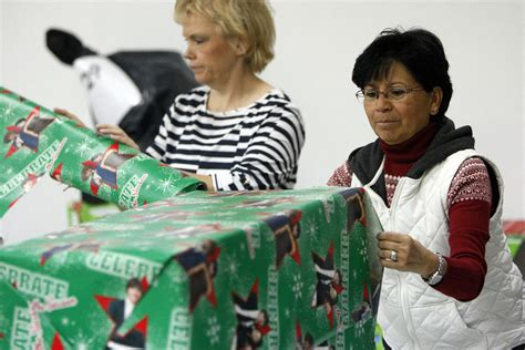 christmas helpers wrap thousands of gifts for low income