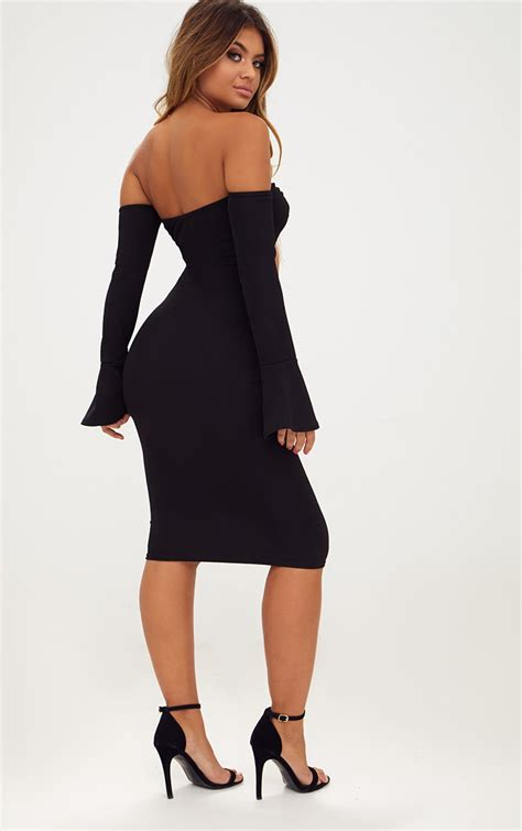 Regine Cut Out Black C8 black o ring cut out bell sleeve midi dress dresses prettylittlething usa