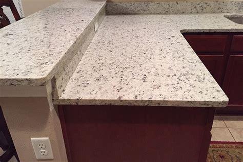 Dallas White Granite Countertops by Branco Dallas Granite Countertops In Kitchen With High Bar