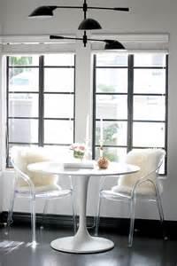 Breakfast nook black pendant white tulip table acrylic chairs fur