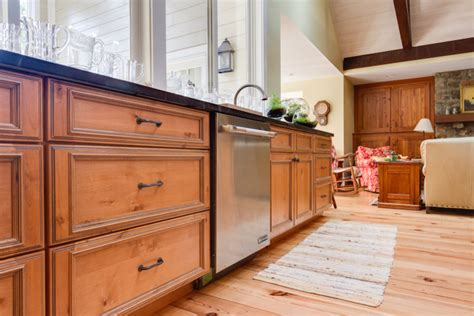 alder wood kitchen cabinets knotty alder kitchen cabinets kitchen rustic with carrera