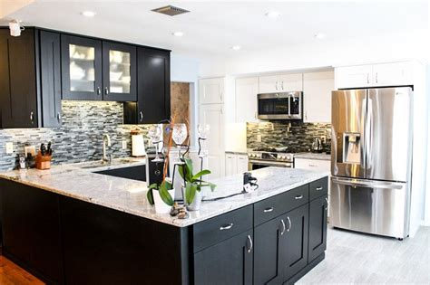 white cabinets and black countertops the contrast of the white countertop with the black