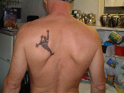 small back tattoos for men small cross tattoos collection