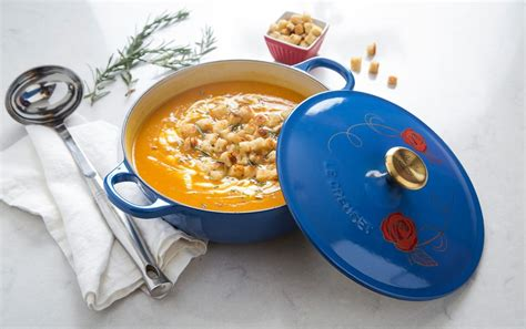 be our guest le creuset this disney inspired cookware line will make your kitchen