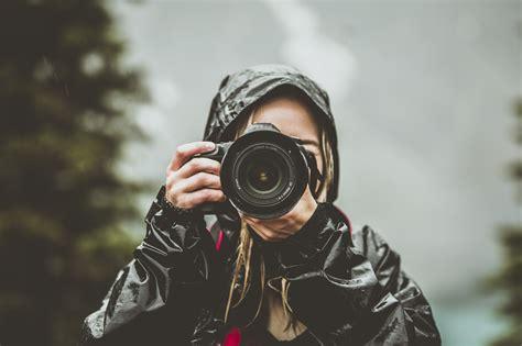 camera woman rain jacket  stock photo negativespace