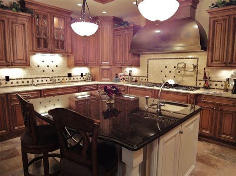 cherrywood cabinets granite white island cherry