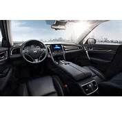 The Interior Adopts All Black Color Theme With Wooden Trims