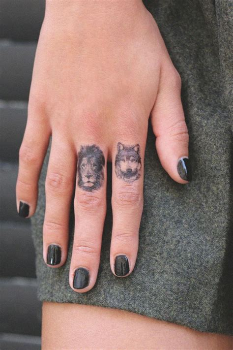 finger tattoo lioness lion and lioness finger tattoo www imgkid com the