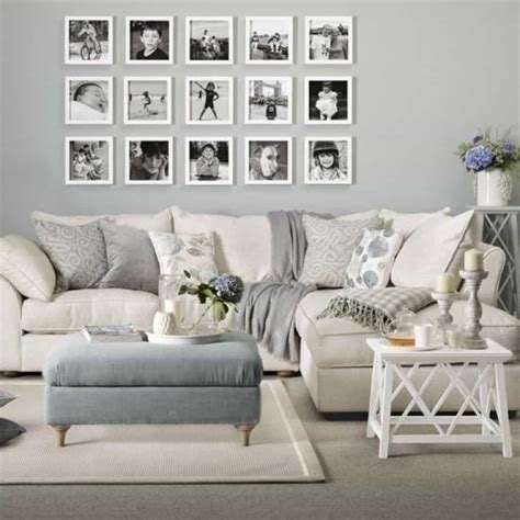 living room with cream sofa living room with wall photos and cream sofa decorate