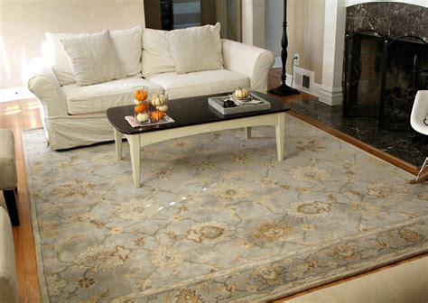 rug in living room points to note on how to put a rug in a living room