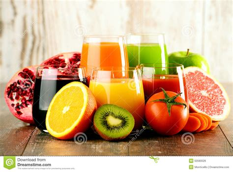 Fresh Fruit Detox Diet by Glasses Of Fresh Organic Vegetable And Fruit Juices Stock