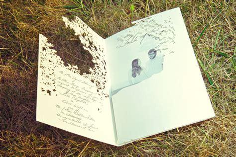 vintage inspired wedding stationery vintage inspired wedding invitation photographed near outdoor wedding venue