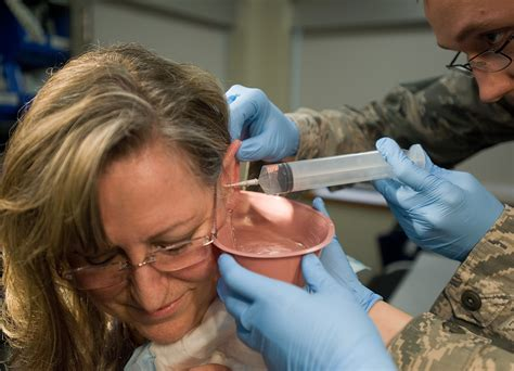 ear cleaning file ear cleaning at dover jpg wikimedia commons