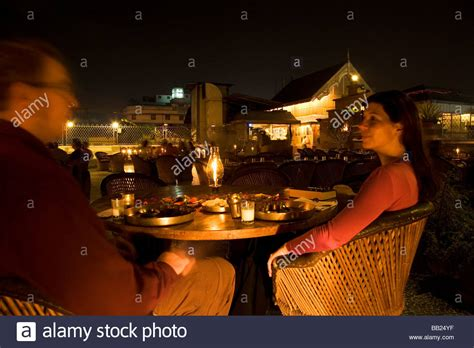 terrace house couple a western couple dine together on the rooftop terrace of