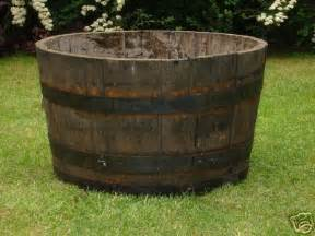half barrel planters look great with flowers or small