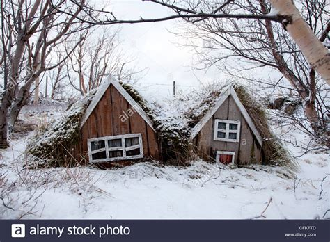 winter houses troll houses in winter snow covered garden in iceland