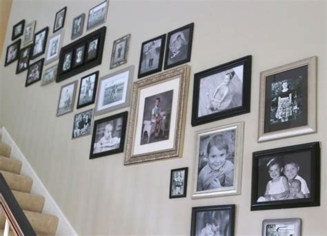 hanging family photos in an open stairwell the decorologist - Hanging Family Photos