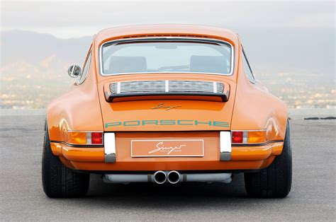 vintage orange porsche singer 911 vs eagle e type choose your weapon
