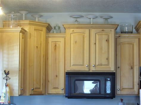 Kitchen Top Cabinets | decorating the top of the kitchen cabinets organize and
