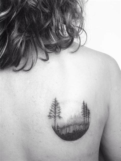 small tattoo on shoulder blade poked forest circle on the right shoulder