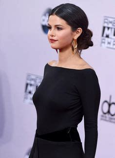 selena gomez wearing a elegant low bunchignon hairstyle beauty and skincare eva longoria low buns and