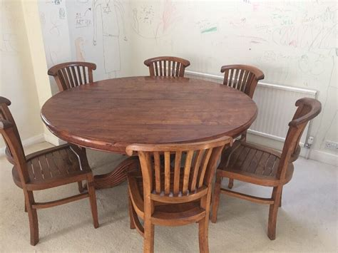solid teak wood dining table and 8 chairs