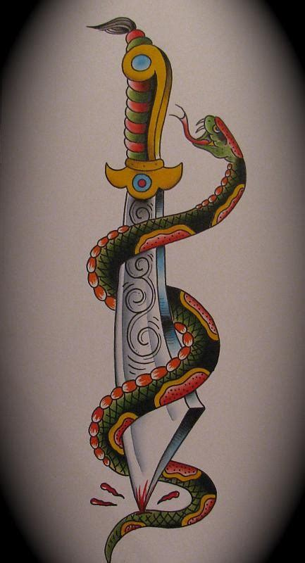 fabulous old snake curled around huge dagger tattoo