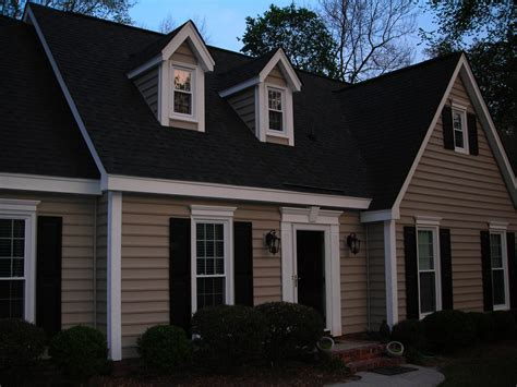 black roof brown house this has similar lines to ours and a similar roof color but has added